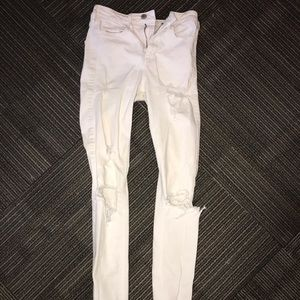 high rise skinny ripped white jeans
